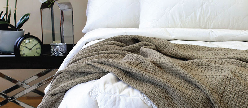 onka paringa wool blanket in bed